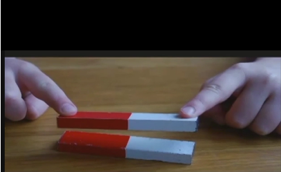 two magnets opposing each other